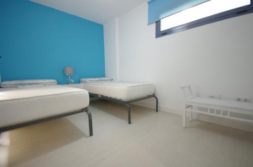 Dormitorio con camas unipersonales