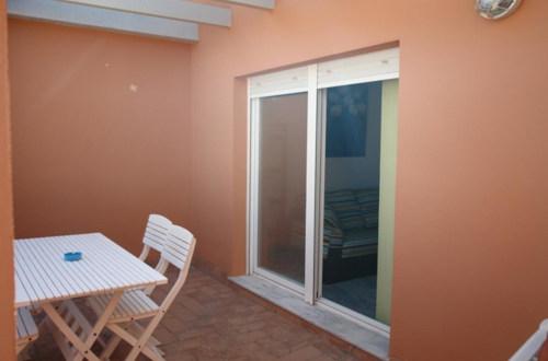 Terraza y acceso al salón